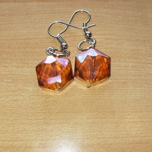 Orange earrings.